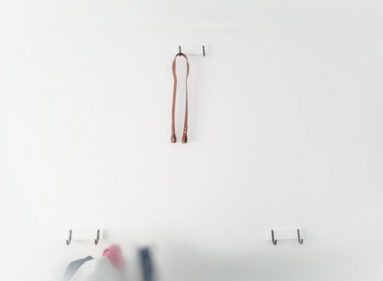 Bike hanger made from 3 HJALMAREN towel hangers and a leather strip