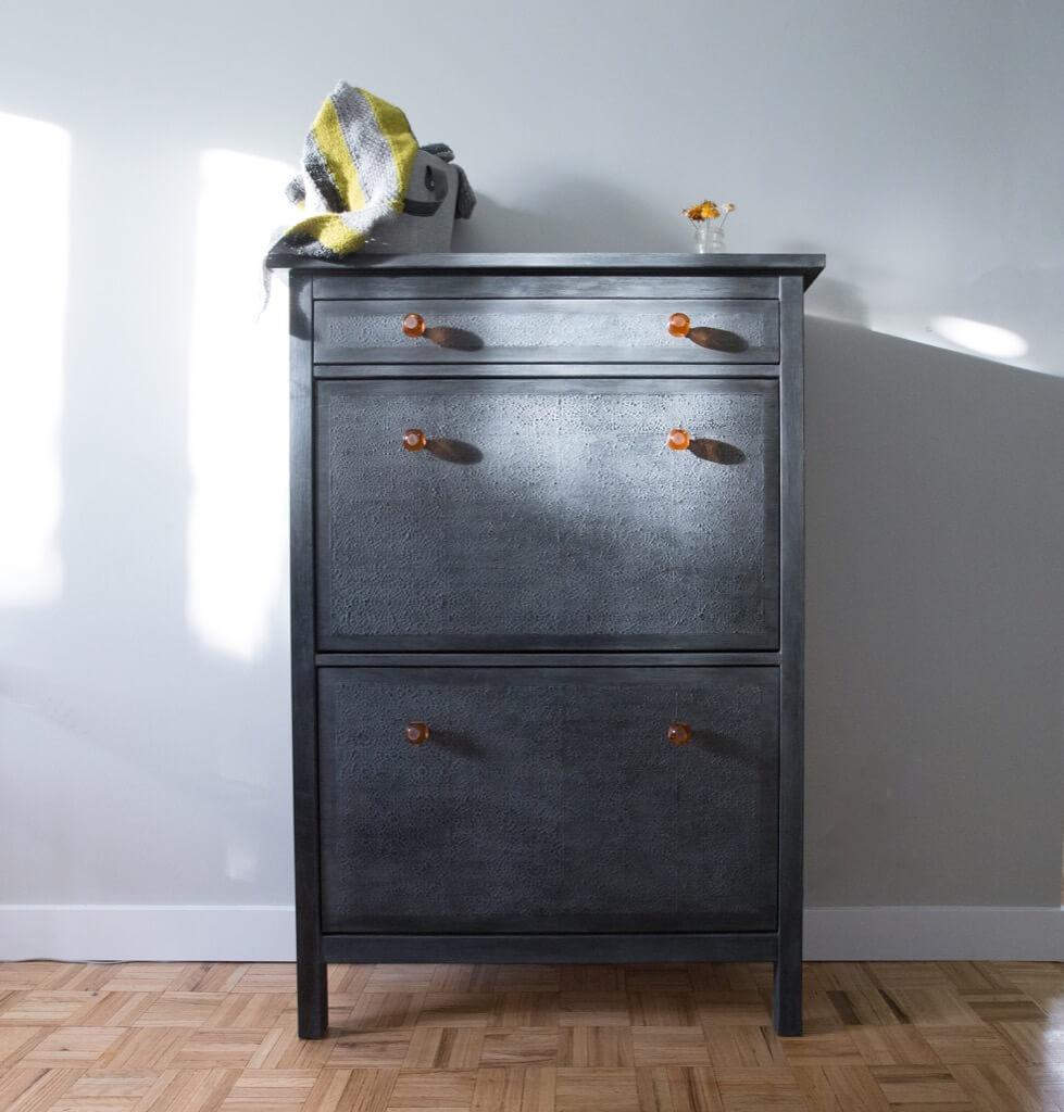 textured black shoe cabinet